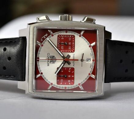 The red second hand and sub-dials are striking on the silver dial.